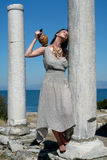 Beautiful Greek young girl holding a vessel royalty free stock image