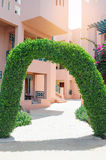 Beautiful green arch with decorative tree at the hotel Royalty Free Stock Photo