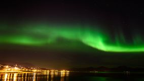 Aurora borealis or northern lights in the sky at Tromso, Norway royalty free stock image