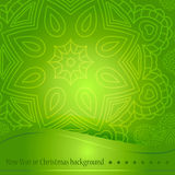 Beautiful green background with ornament for Christmas. A circular ornament, mandala. Celebratory bright background for Christmas. Royalty Free Stock Image
