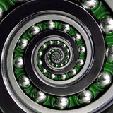 Beautiful green cage specific unusual Industrial clockwise Spiral Ball Bearing. Double spiral bearing manufacturing technology. Ab Royalty Free Stock Photos