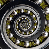 Beautiful green cage specific unusual Industrial clockwise Spiral Ball Bearing. Double spiral bearing manufacturing technology. Ab Royalty Free Stock Images