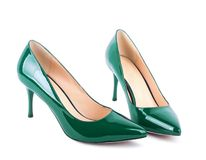 Beautiful green classic women shoes isolated Stock Images