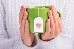 Beautiful green cup with love tea bag. Stock Image