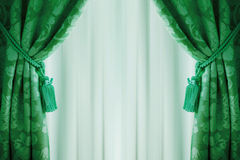 Beautiful green curtains with tassels and tulle Stock Photo