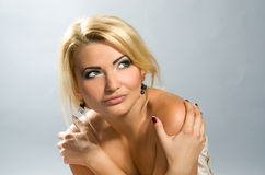 Beautiful green-eyed girl with blonde hair Stock Photography