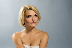 Beautiful green-eyed girl with blonde hair Royalty Free Stock Photo