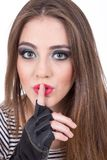 Beautiful green eyed girl gesturing shhh Royalty Free Stock Photo