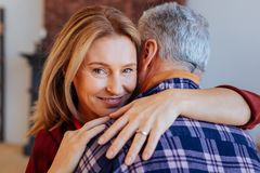 Beautiful green-eyed woman hugging her supportive man royalty free stock photos