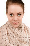 Beautiful green eyed woman who looks straight into the camera Royalty Free Stock Photo