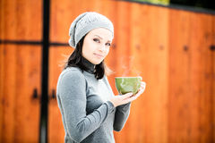 Beautiful green eyed young woman in warm clothes Stock Photo