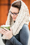 Beautiful green eyed young woman in warm clothes Stock Photography