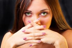 Beautiful green eyes. The girl with green eyes of a hand at the person Stock Photo