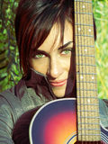 beautiful green eyes girl and her guitar Royalty Free Stock Photography