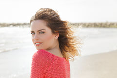 Beautiful green eyes woman smiling on a windy day. At the seaside Royalty Free Stock Photography