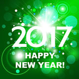 Beautiful green fireworks with  greetings  Happy New Year 2017! Royalty Free Stock Image