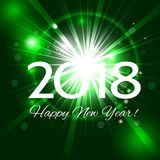Beautiful green fireworks with  greetings Happy New Year 2018!. Beautiful green holiday background abstract fireworks with a bright flash of light and the Stock Image