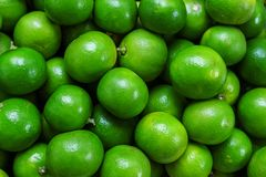 Beautiful Green Fresh and Ripe Lime in the Market.  stock photos