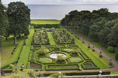 Beautiful green geometric garden view from above. Beautiful green geometric garden near the sea view from above Stock Image