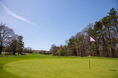 Beautiful green golf landscape and blue cloud. At Woburn Massachusetts Royalty Free Stock Image