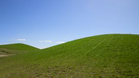 Beautiful green hill on blue sky background. Beautiful green hill on blue sky background Stock Photos
