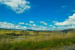 Beautiful green hill view of Australia countryside with cloudy sky. A Beautiful green hill view of Australia countryside with cloudy sky stock image