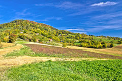 Beautiful green hill with vineyard cottages. Kalnik mountain, Prigorje, Croatia stock photo