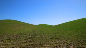 Beautiful green hill on blue sky background. Beautiful green hills on blue sky background Royalty Free Stock Image