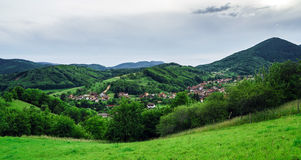 Beautiful green hills in little village. Breitenbach, Alsace, France Royalty Free Stock Image