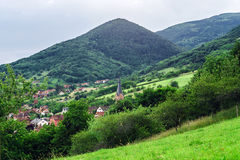 Beautiful green hills in little village. Breitenbach, Alsace, France Royalty Free Stock Images