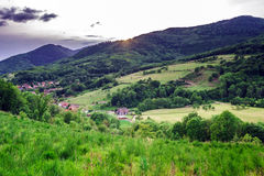 Beautiful green hills in little village Royalty Free Stock Photography