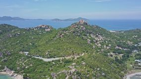 Hilly peninsula with stones against Azure ocean and clear sky stock footage