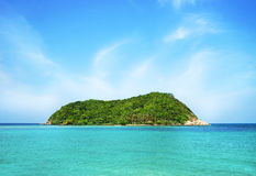 Beautiful green island on a sky and ocean background Royalty Free Stock Photo