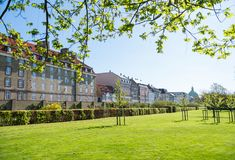 Beautiful green lawn with bushes and old buildings. In copenhagen, denmark stock photos