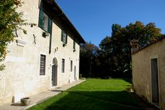 Beautiful green lawn in front of an old building that is part of the village of Strassoldo Friuli (Italy) Royalty Free Stock Photos