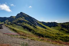 Beautiful green mountain landscape with bright blue sky. North Caucasus. Stock Images