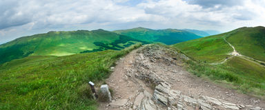 Beautiful green mountain panorama with blue sky above Royalty Free Stock Photos
