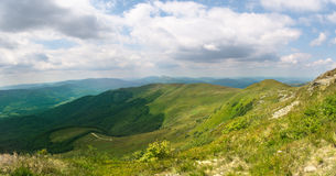 Beautiful green mountain panorama with blue sky above Royalty Free Stock Photo