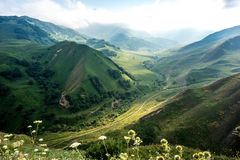 Beautiful green mountain valley. With river on pass Royalty Free Stock Photo