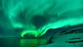 Green northern lights in Iceland. Beautiful green Northern Lights photographed in north Iceland in February stock photo