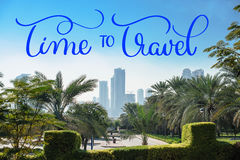 Beautiful green park on the background of skyscrapers houses and Time to travel text. Calligraphy lettering hand draw Stock Image