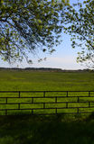Fenced Green Pasture Royalty Free Stock Image