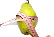 Beautiful green pear wound in centimeter. Stock Photos