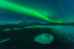 A beautiful green and red aurora over the Jokulsarlon lagoon, Iceland