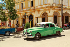 Beautiful green retro car in cuban town Stock Image