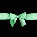Beautiful green ribbon gift bow. Isolated on black background Royalty Free Stock Photo