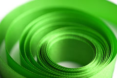 Beautiful green ribbon in spiral form Stock Photos