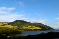 Beautiful Green Rolling Hills Surrounding Loch Ness in Scotland Royalty Free Stock Photos