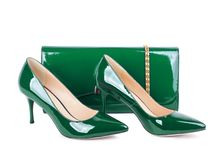Beautiful green shoes with clutches Stock Photo