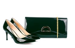 Beautiful green shoes with clutches on white isolated Royalty Free Stock Photo